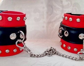 Red and black faux leather handcuffs/bracelets