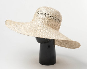 6bcc61a612a96 New hollowed-out woven drooping large-brim sisal straw hat outdoor sunshade  sun protection beach along the big pot straw hat