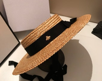 b880f4bc14b Flat top hat for women can be matched with sun protection beach hat for  holiday show style straw hat