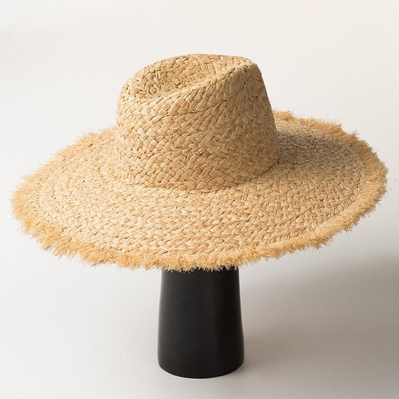 5307405a8f585 Hand knitted buffed edge raffia straw hat for summer travel