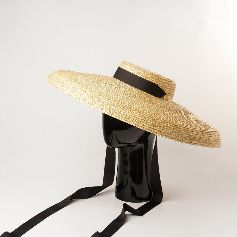 1950s Women's Hat Styles & History ropean and American retro flat top under a large folding hat brim straw hat stage show modeling large brim straw hat sun hat $59.00 AT vintagedancer.com