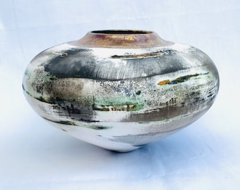 A smoke-fired ceramic pot which would make a very special birthday gift.