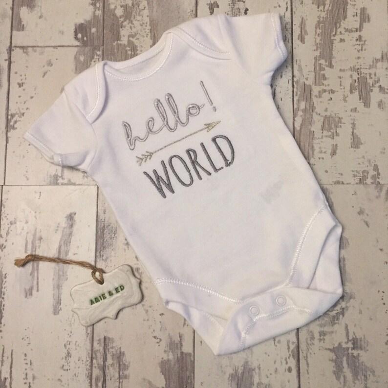 60821394a Baby Onesie. Embroidered Baby Vest. Hello World Baby Top.