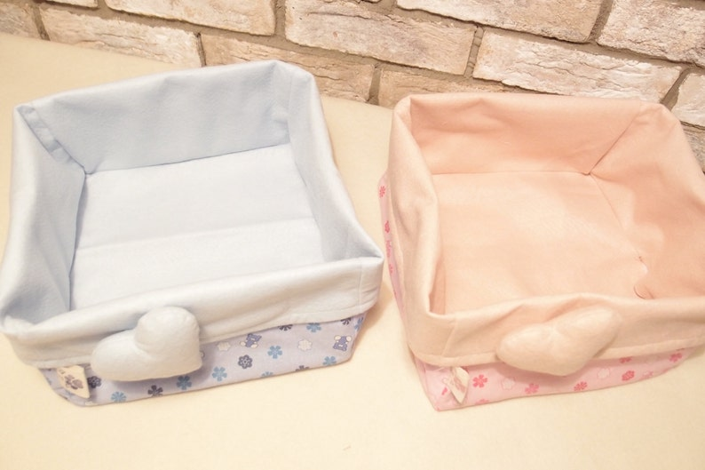 Basket of cloth-carrying diapers with pink heart.
