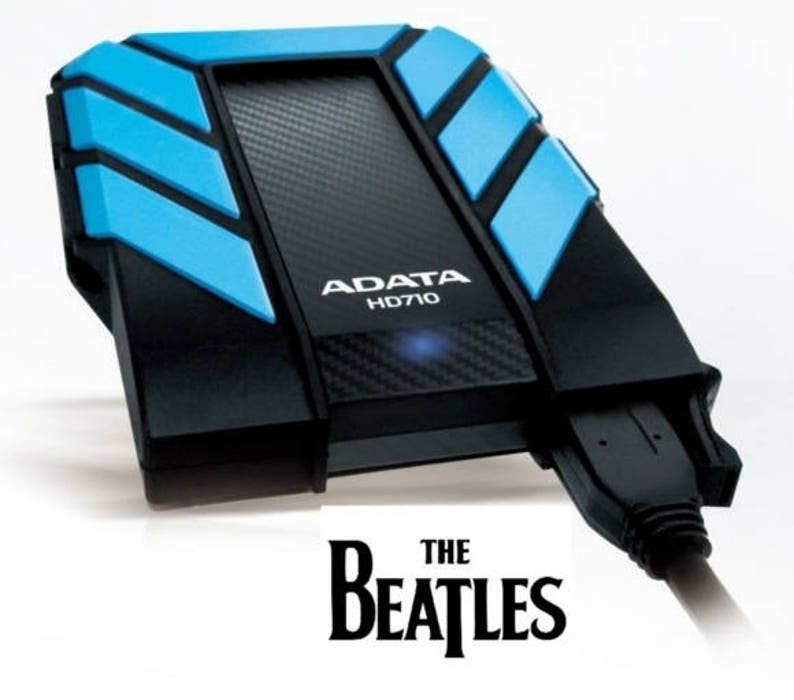 1,300+ Beatles CD External Portable USB Storage Device