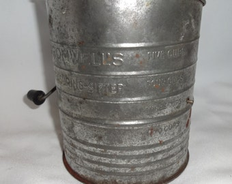 Bromwell's Measuring Sifter  Tin with wood nob.