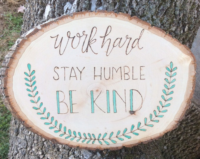 Work hard, stay humble, be kind woodburned and water colored wood slice