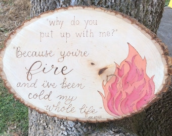 Fire and love woodburned and water colored wood slice