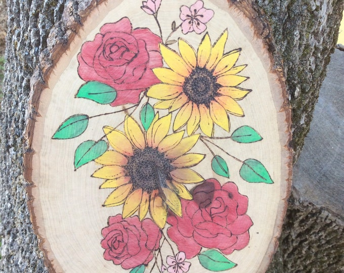 Floral woodburned and water colored wood slice