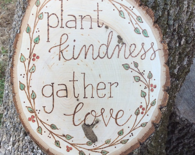 Kindness and love woodburned and water colored wood slice