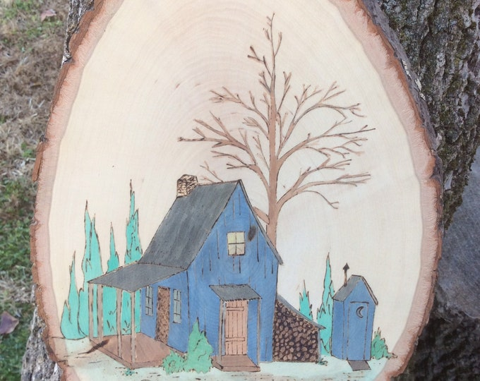 Cabin scene woodburned and water colored wood slice