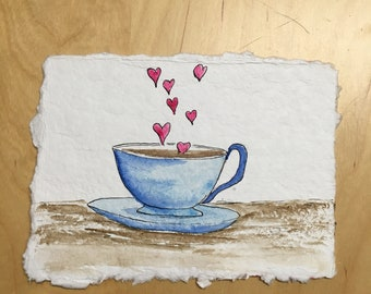 """Hand-Painted watercolor art card. A blue teacup with heart-shaped steam, approx. 4.5""""x6"""". Spread the love! Mailable art"""