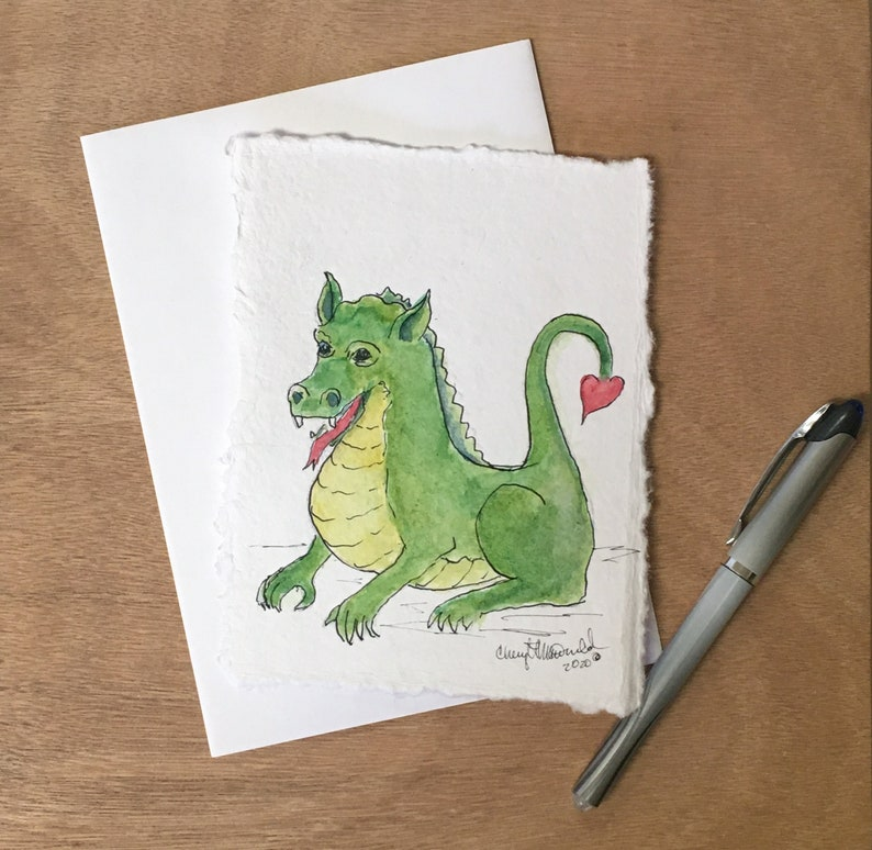Send your love with this cute green dragon with a heart-shaped image 0
