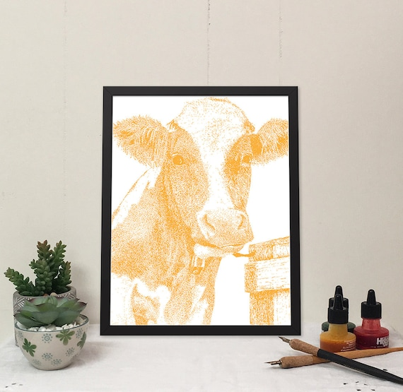 Moo-ilyn Moo-nroe in Orange is a stylish cow that will brighten your wall and bring some fun to your home.