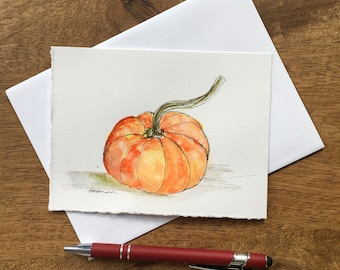 Celebrate Autumn with this hand-painted watercolor and black pen harvest greeting card of a pumpkin.