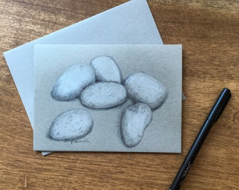 Gray and White Stones drawn in layers of colored pencil on 80lb gray toned cardstock make a unique way to celebrate Autumn.