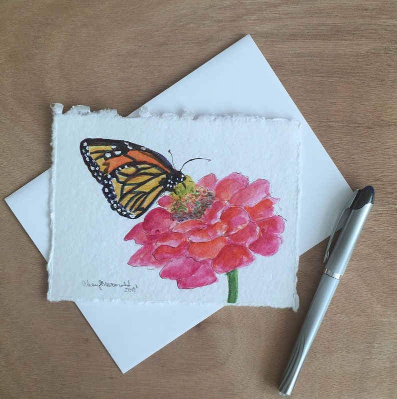 A Monarch Butterfly sipping on a bright pink Spring flower. A image 0