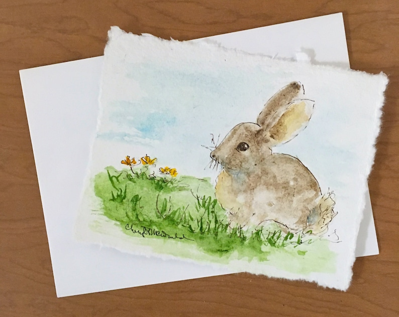 Spring Bunny in a field of new flowers. Bring Spring to you or image 0