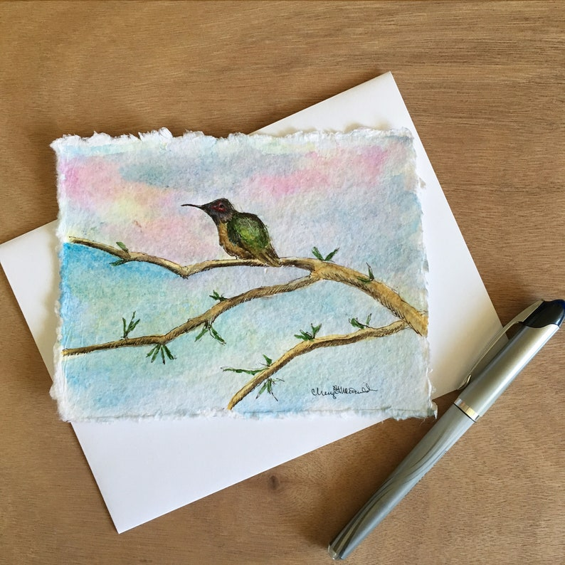 Hand-painted watercolor card of a hummingbird sits on a branch image 0