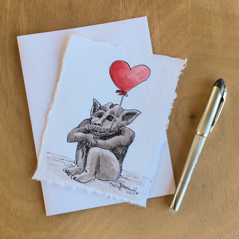 A little gargoyle holding a red heart balloon will make you image 0
