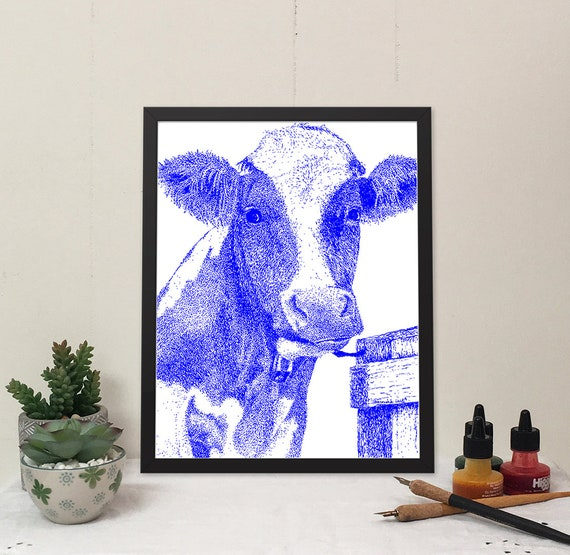 Moo-ilyn Moo-nroe in Bleu Blue, is a stylish cow that will brighten your wall and bring some fun to your home.
