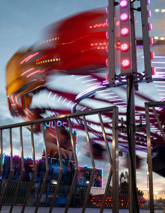 Fair fun IV digital photo print matted with a white mat of spinning carnival ride.
