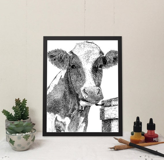 Moo-ilyn Moo-nroe in Noir Black, is a stylish cow that will brighten your wall and bring some fun to your home.