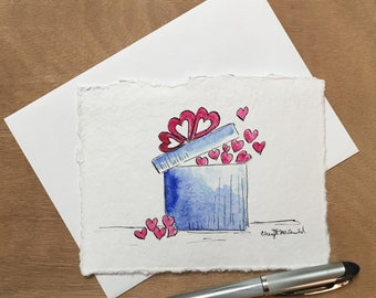 """Gift-Wrapped Love in a pretty blue box filled with hearts, this Hand Painted Valentine approx. 4.5""""x6"""". Spread the love!"""