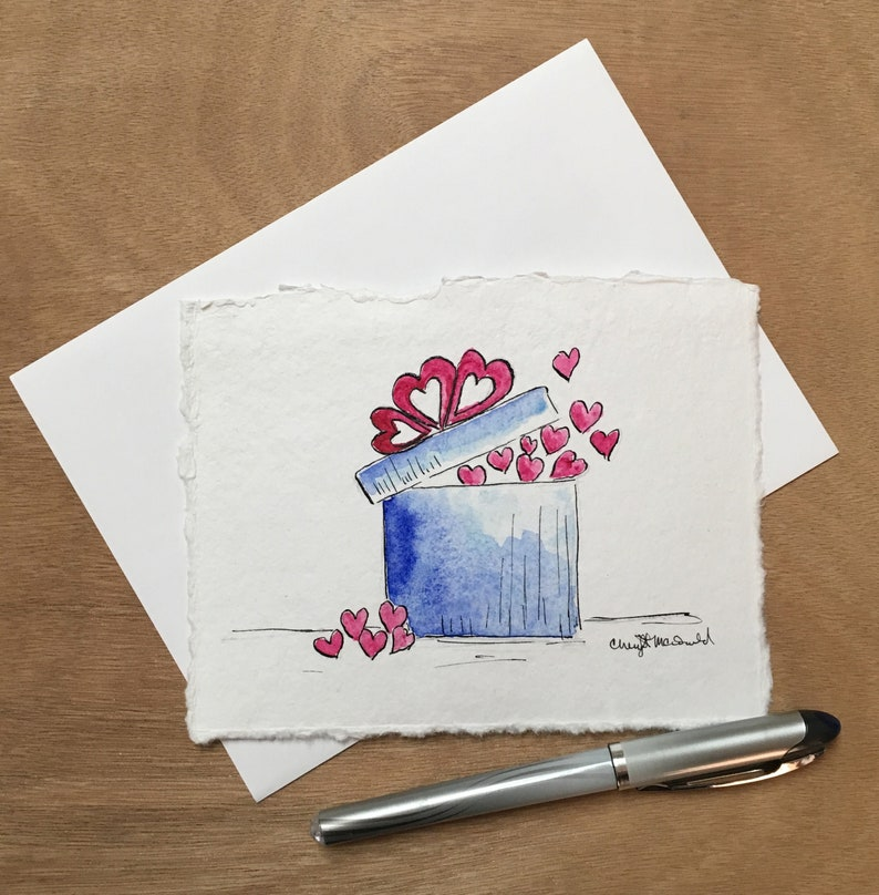 Gift-Wrapped Love in a pretty blue box filled with hearts image 0