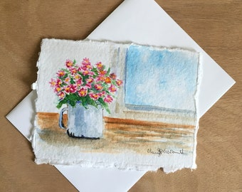 """A Cup Full of Daisies sitting on a window sill. A nice thank you card or Mother's day card. Hand-painted watercolor card approx. 4.5""""x6""""."""