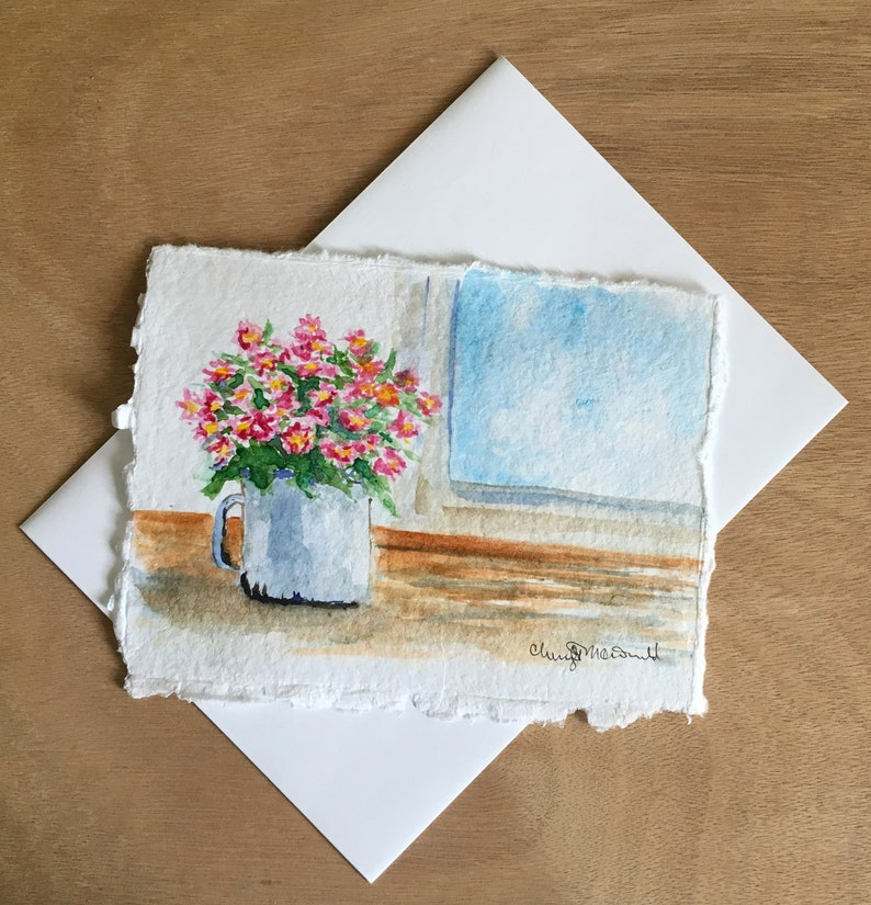 A Cup Full of Daisies sitting on a window sill. A nice thank image 0
