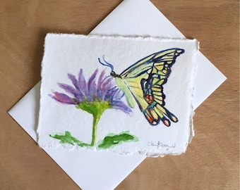 A Swallowtail Butterfly snacking on a purple Spring flower. A nice thank you card or Mother's day card. Hand-painted watercolor card.