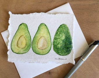 """Hand-painted notecard on art paper Avocado inside and out painted in watercolor. Kitchen art, mailable art, art notecard approx. 4.5""""x6""""."""