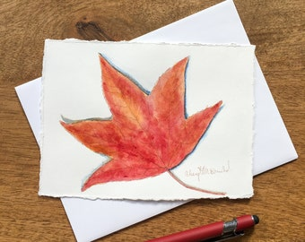 Celebrate Autumn with this hand-painted card with watercolor and sepia pen harvest greeting card of a Red Chinese Gum Tree Leaf