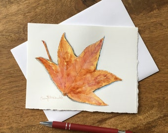 Celebrate Autumn with this hand-painted card with watercolor and sepia pen harvest greeting card of a Chinese Gum Tree Leaf