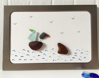 Brushed silver frame magnet with sea glass sailboat & shark fin and pebble bird