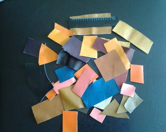 over 20 different color leather scraps