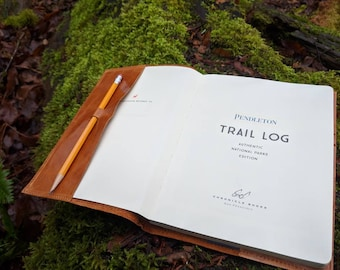 "Trail Log for National Parks Book with Leather Cover and the quote ""The Mountains are I calling and I must go."""