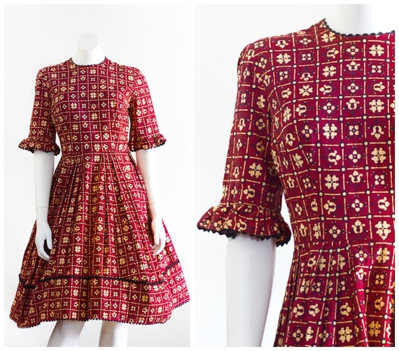 1950s burgundy and ochre fit and flare dress