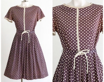 1950s brown polka dot belted fit and flare dress