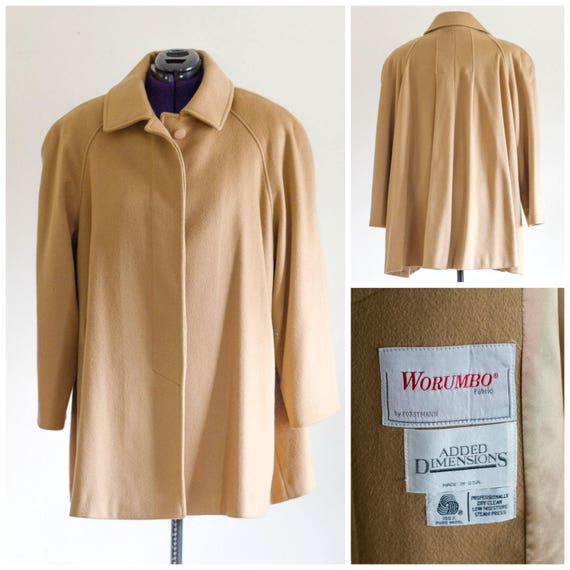 Camel color wool swing coat with large shoulder pa