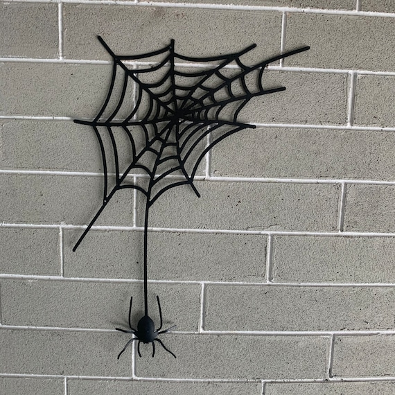Metal wall hanging spider and web