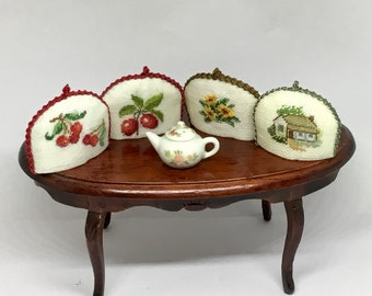 Miniature tea cosy for dollhouse with linen embroidery.