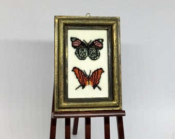 Miniature dollhouse picture, with butterflies embroidered on silk gauze.