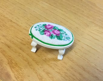 Miniature footrest for dollhouse with petit point embroidery on silk gauze.