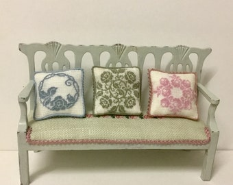 Miniature dollhouse cushion, with one-tone silk embroidery on linen canvas. Scale 1:12.