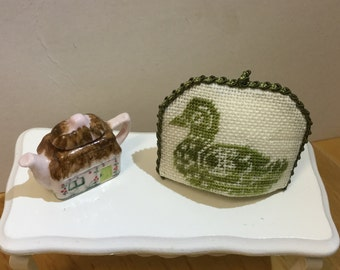 Miniature cozy for dollhouse with monocolour embroidery on linen canvas.