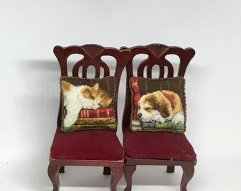 Miniature dollhouse cushion with kitten or little dog embroidered in petit point on silk gauze. Scale 1:12