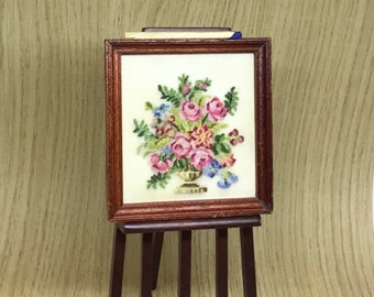 Miniature dollhouse square with rich bouquet embroidered at petit point on silk gauze.