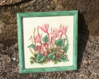 Miniature dollhouse with cyclamen embroidered on silk gauze.
